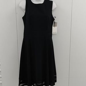 Calvin Klein black fit and flare illusion hem dres